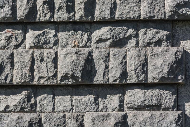 Mur des briques noires de granit image stock