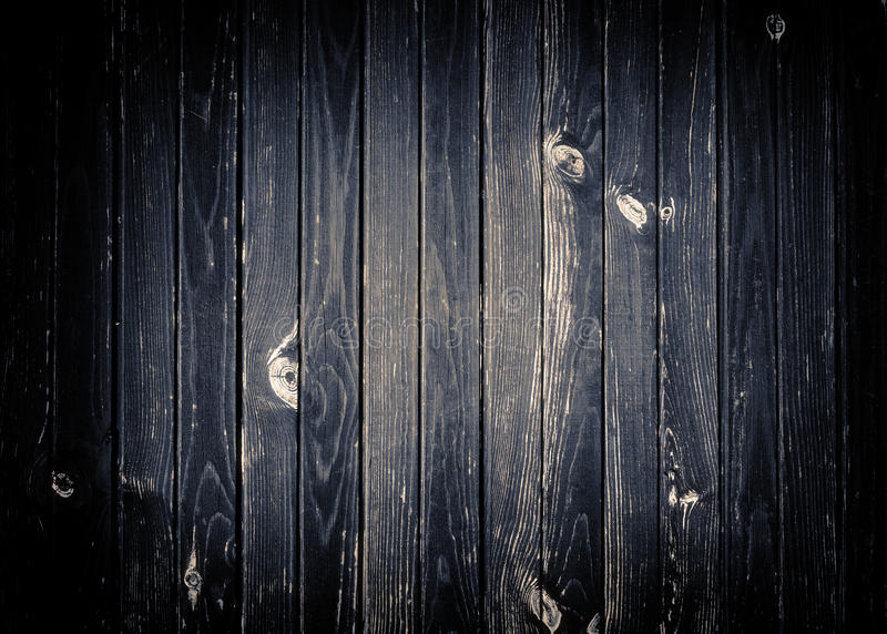 Mur en bois rayé gris-foncé, barrière, table ou image libre de droits
