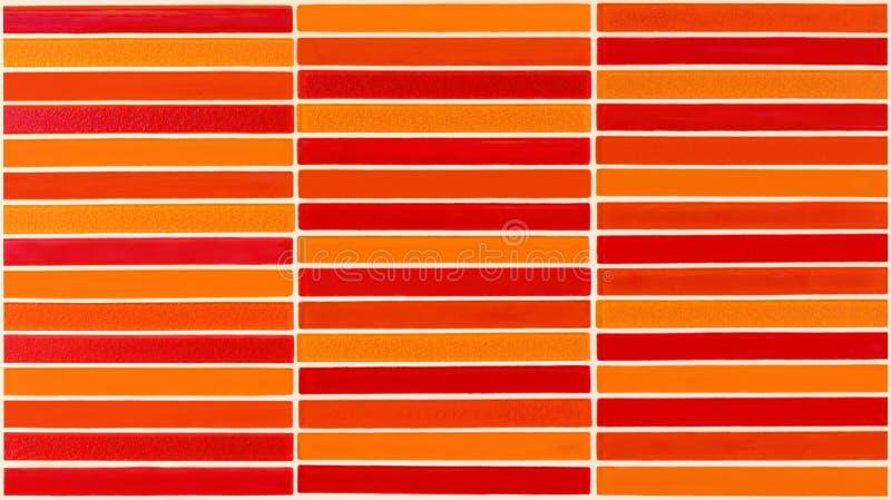 Mur en céramique rouge et orange carrelé photographie stock libre de droits
