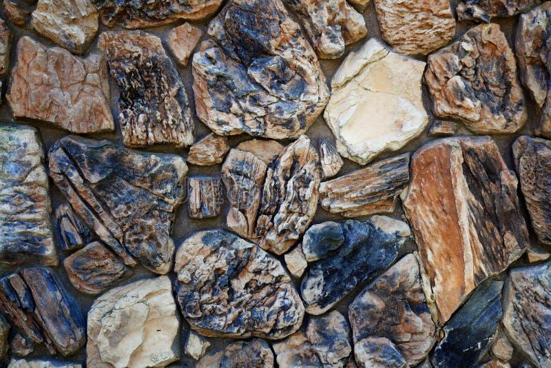 Mur en pierre beige et noir images stock