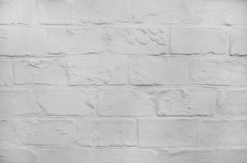 Mur en pierre blanc texturisé pour le fond image stock