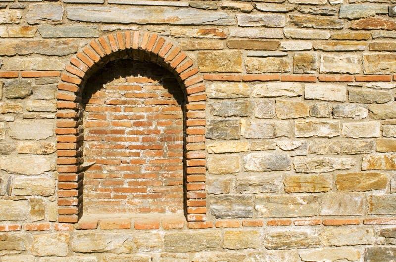 mur en pierre de place de brique vieux photo stock