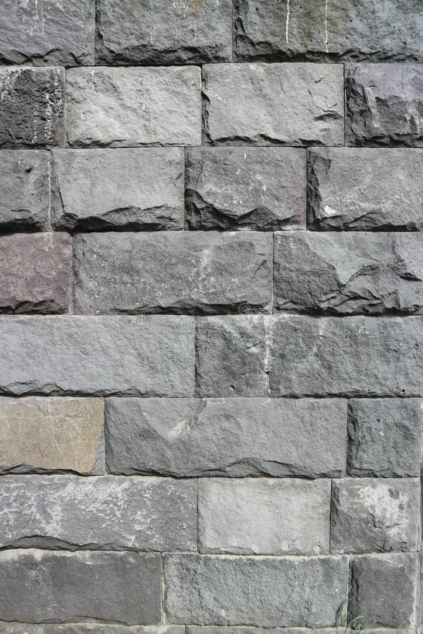 Mur en pierre rectangulaire gris de blocaille, rubblework photo libre de droits