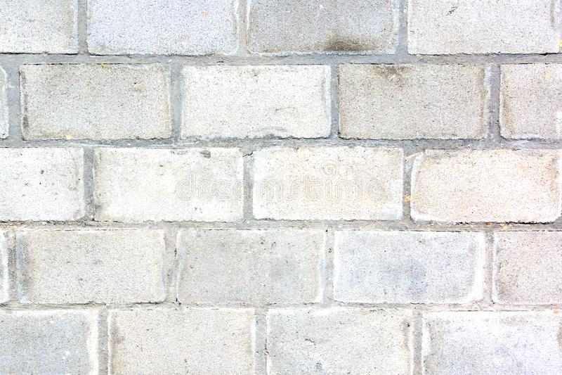 Mur gris fait de grandes briques La texture de la brique Fond vide images stock