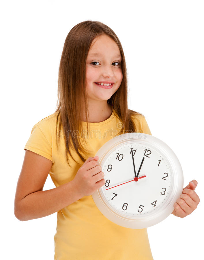 Mur-horloge de fixation de fille d'isolement sur le blanc images stock