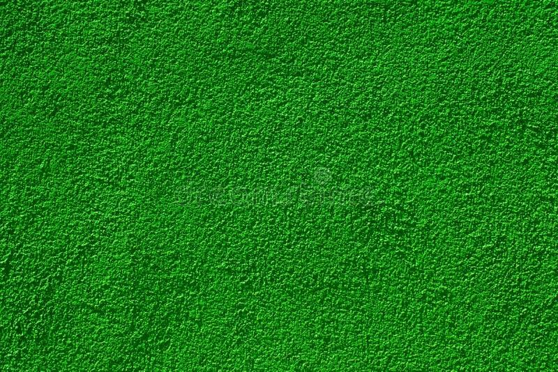 Mur peint par vert dans l'éclairage lumineux image stock