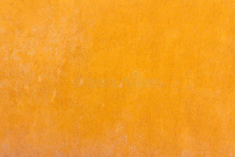 Mur plâtré par jaune image stock