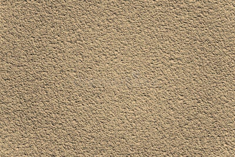 Mur rocailleux texturisé brun décoratif de plâtre image stock