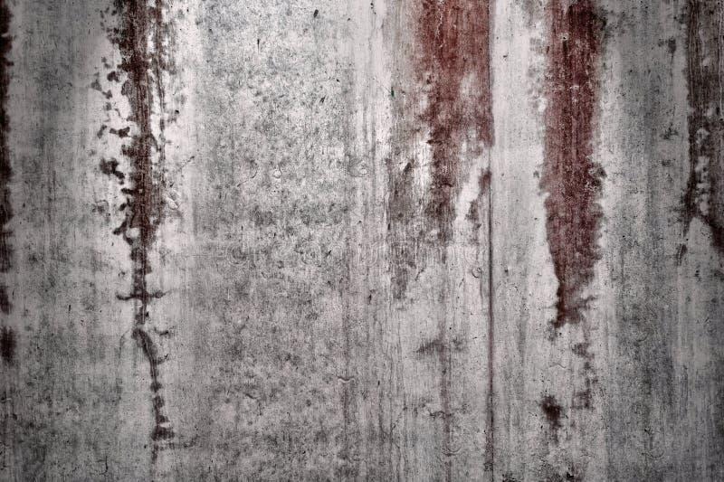 Mur texturisé avec les souillures rouges