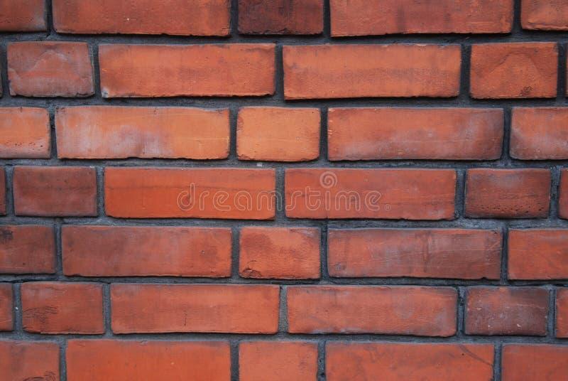 Mur texturisé de briques Vieux mur de briques en pierre orange à Londres photos libres de droits