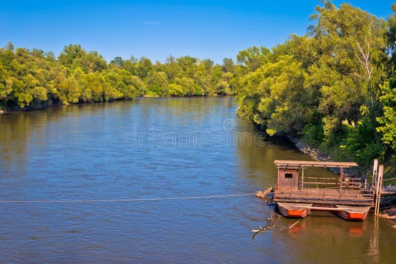 Mura river ferry boat and green landscape. Medjimurje region of Croatia stock photo