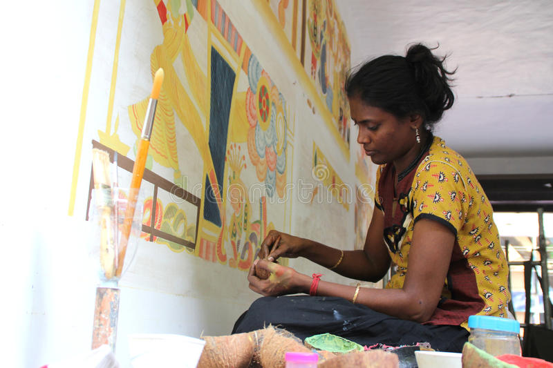 Mural artist. Krishna Priya paints on the wall during the International Mural painters camp organized by Cultural Department of Kerala on May 21,2013 in stock image
