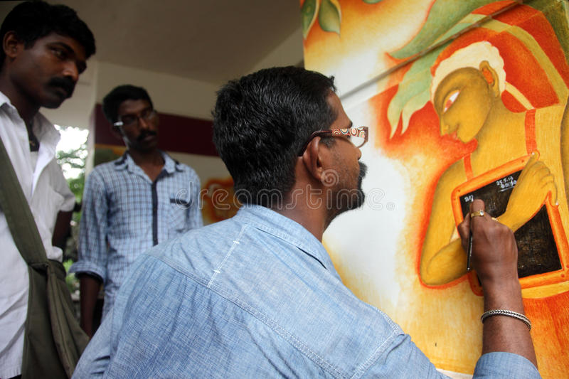 Mural artist. Suresh Muthukulam paints on the wall during the International Mural painters camp organized by Cultural Department of Kerala on May 25,2013 in royalty free stock image