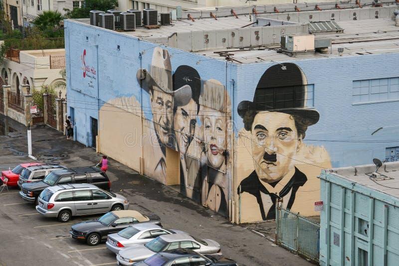 Mural con los retratos de John Wayne, Elvis Presley, Marilyn M foto de archivo