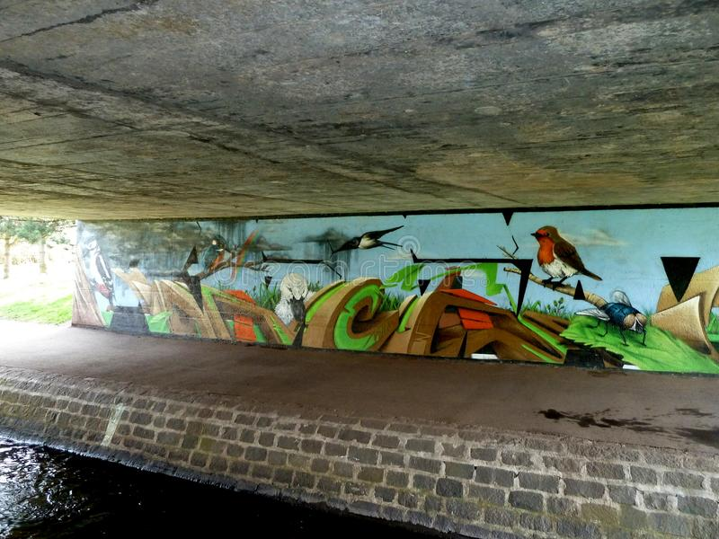 December assignment. This mural decorates the road bridge which crosses the figate burn on its way to the sea royalty free stock image