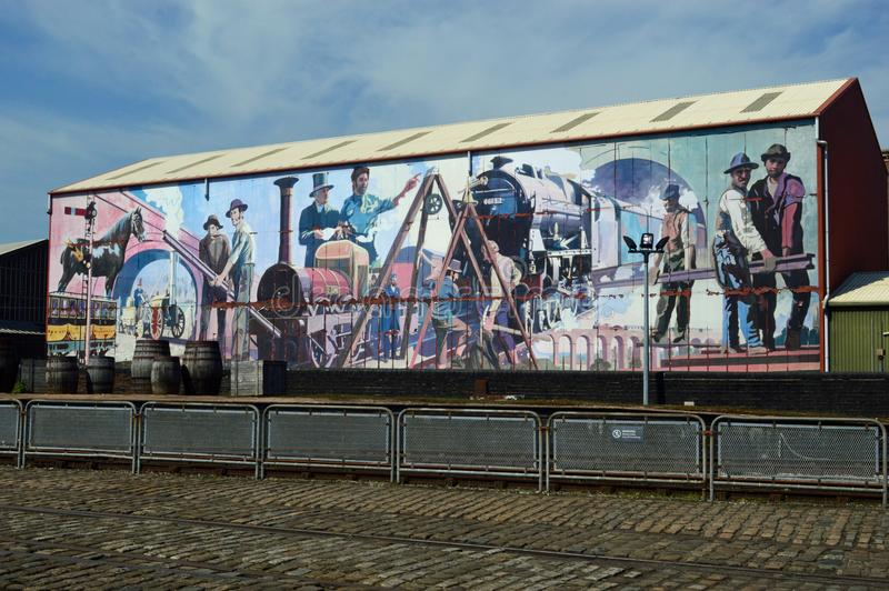 Mural Manchester Museum of Science and Industry. Museum of Science and Industry Liverpool Road exterior shot of coloured mural at the site of the world`s first royalty free stock image
