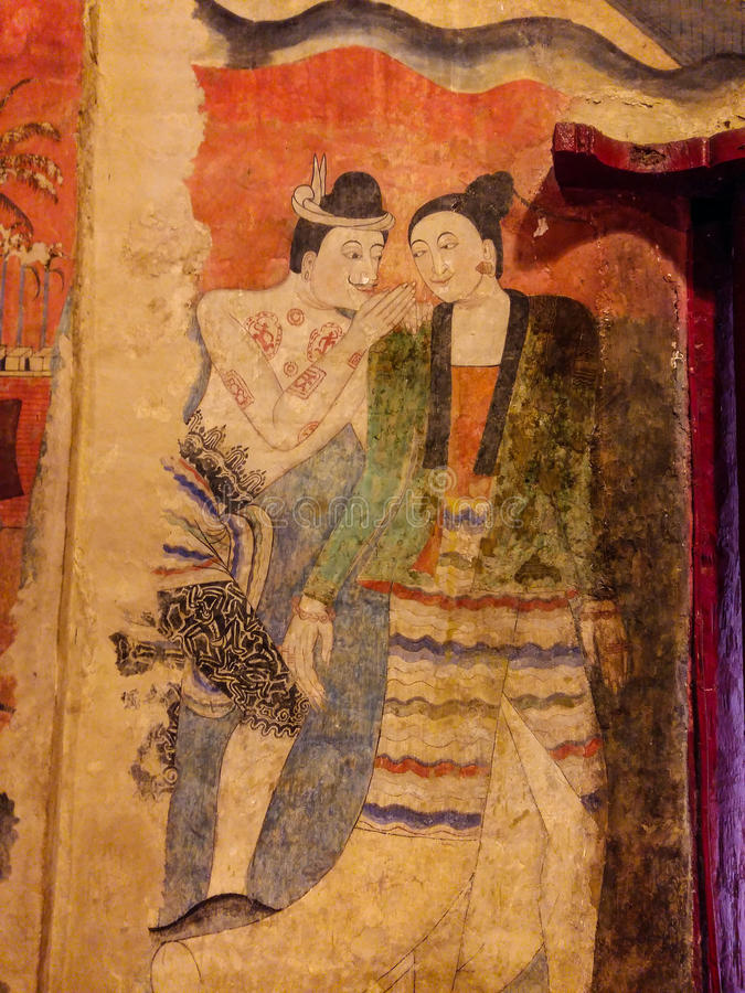 Mural painting of a man whispering to ear of a women in wat Phumin, nan, thailand. Beautiful Mural painting of a man whispering to ear of a women in wat Phumin royalty free stock photography