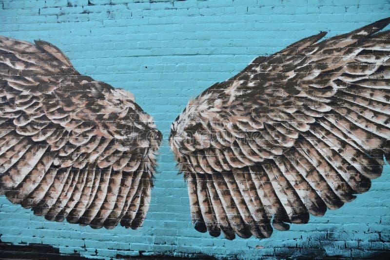 Bird wings mural in alley, Corvallis, Oregon. This is a mural of a pair of bird wings in an alley in downtown Corvallis, Oregon royalty free stock photos