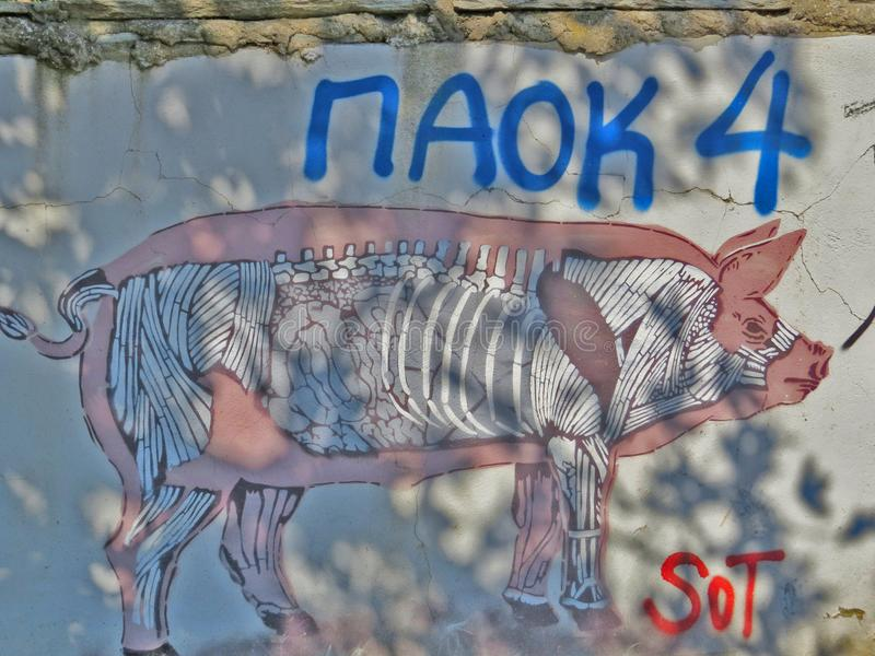 Mural of a pig from unknown artist on a wall in Thessaloniki. royalty free stock images