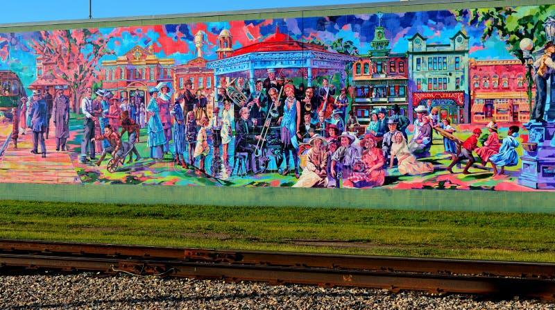 Murale 1920 di era del materiale illustrativo della via su costruzione immagine stock libera da diritti