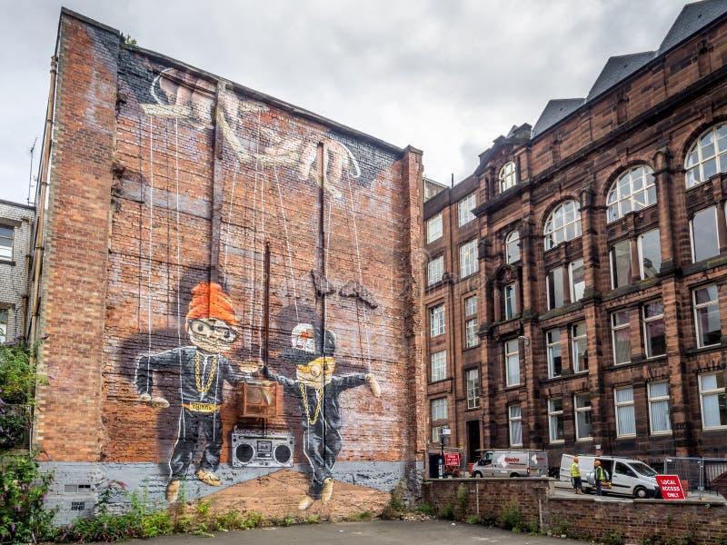 Murales de la calle en Glasgow central fotos de archivo libres de regalías