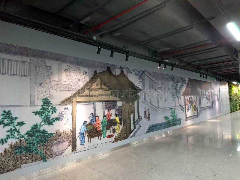 Murals adorn a subway station in shenzhen, China. Murals adorn the che gong miao subway station in shenzhen stock photography