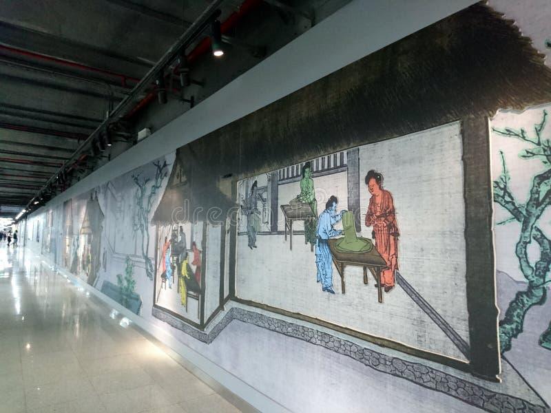 Murals adorn a subway station in shenzhen, China. Murals adorn the che gong miao subway station in shenzhen royalty free stock photos