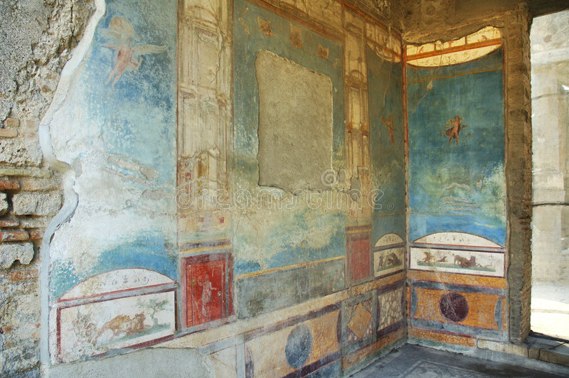 Murals on the walls in Pompeii. Murals on the walls in the ancient roman city of Pompeii royalty free stock photo