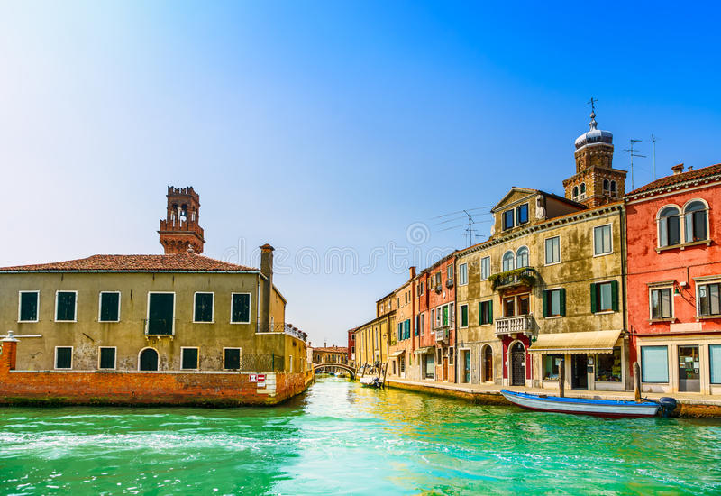 Murano glass making island, water canal and buildings. Murano glass making island, water canal, bridge, boat and traditional buildings. Venice or Venezia, Italy stock photo