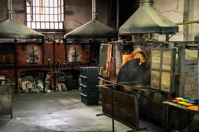 Interior of an artistic glassworks in Murano, Venice. Ancient furnace for blown glass processing. stock image