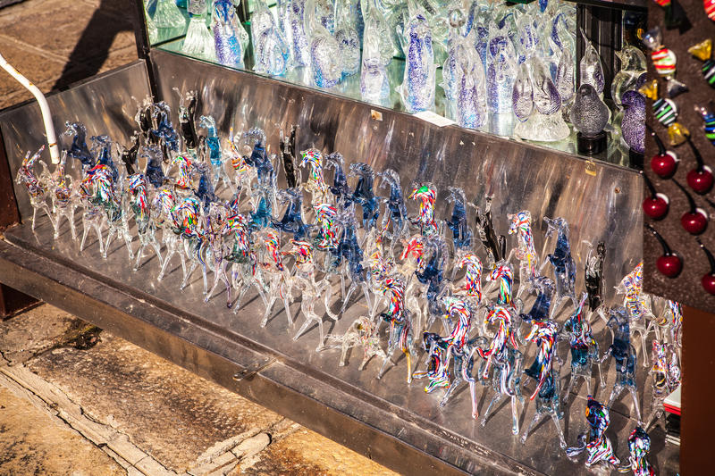 MURANO, ITALY - AUGUST 19, 2016: Famous traditional glass art object in old town of Murano island close-up on August 19, 2016. In Murano, Italy royalty free stock image