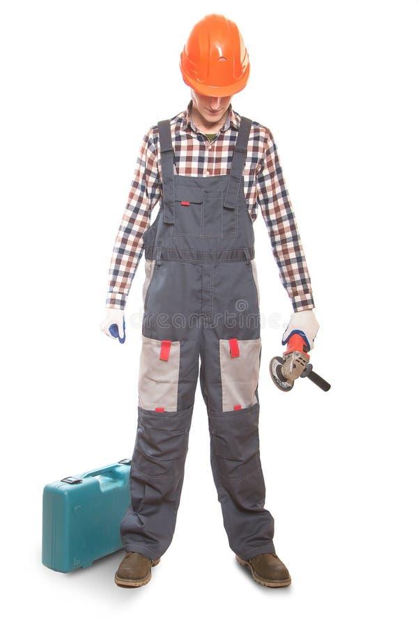 muratore con uno strumento nelle mani immagini stock