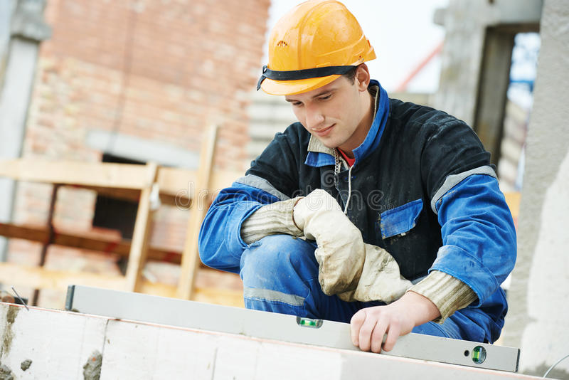 Muratore del lavoratore del muratore della costruzione fotografia stock