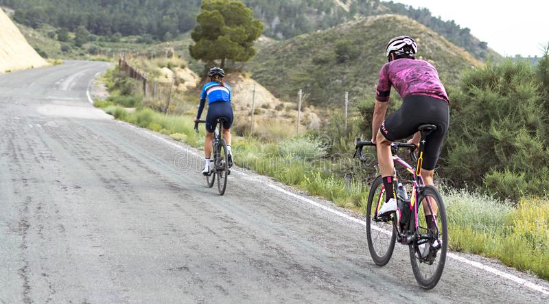 Murcia, Spain, April 17, 2019: Healthy lifestyle - teenage girl and boy cycling royalty free stock photo