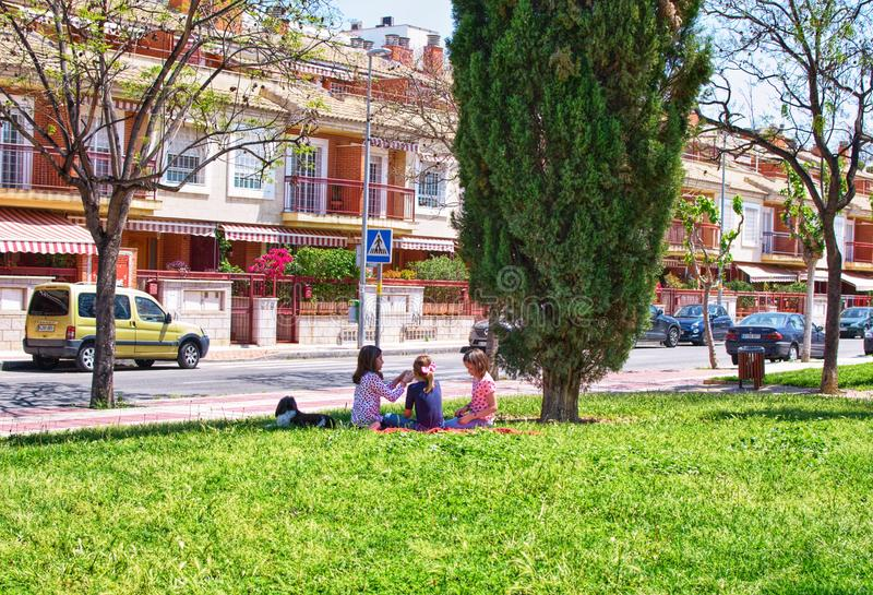 Murcia, Spain, May 1, 2019: Children play on the grass in the city park. Picnic in the city royalty free stock images