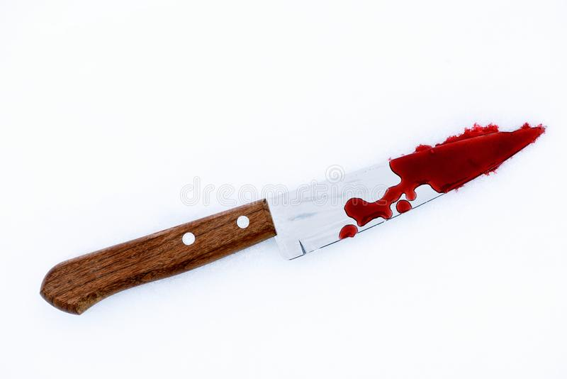 Murder Weapon Knife with Blood Splats and Drops on Snow royalty free stock photo