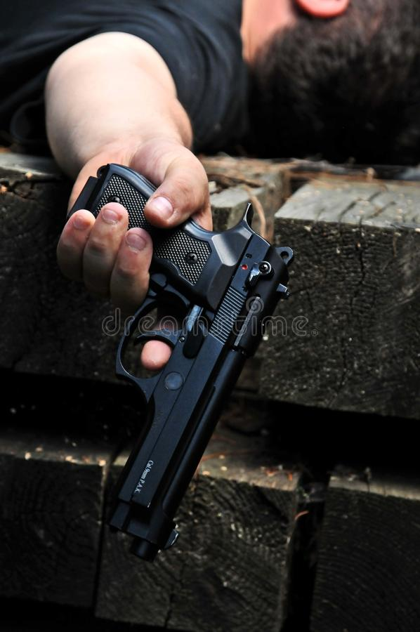 Murdered man with a gun stock images