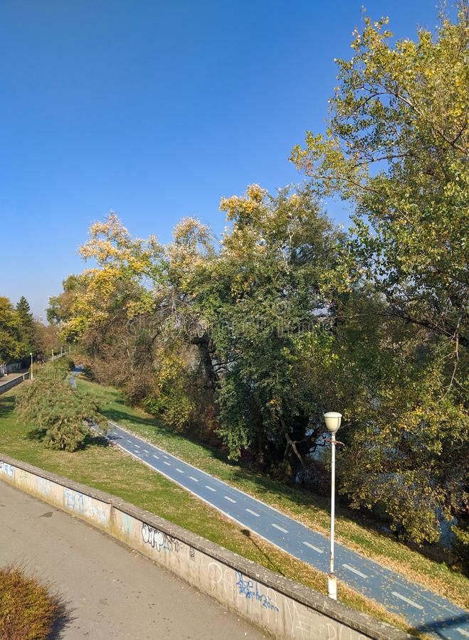 Mures river and a bicycle trail - Arad, Romania. Mures river and a bicycle trail on a sunny autumn day - Arad, Romania royalty free stock photography