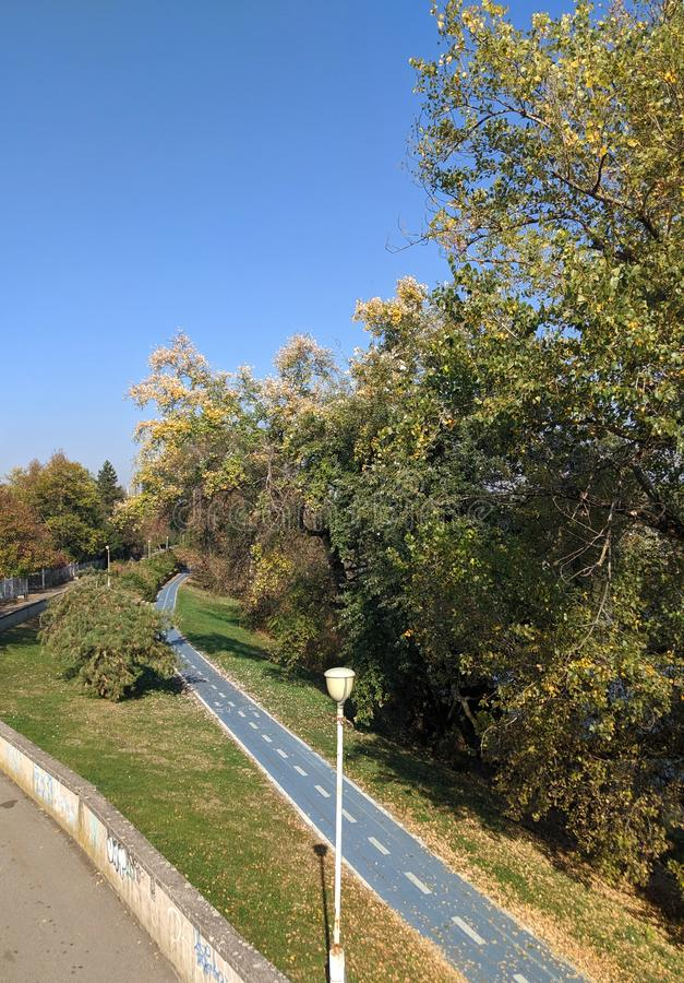 Mures river and a bicycle trail - Arad, Romania. Mures river and a bicycle trail on a sunny autumn day - Arad, Romania stock photo