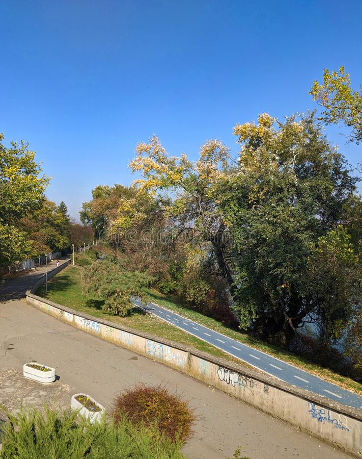 Mures river and a bicycle trail - Arad, Romania. Mures river and a bicycle trail on a sunny autumn day - Arad, Romania royalty free stock images