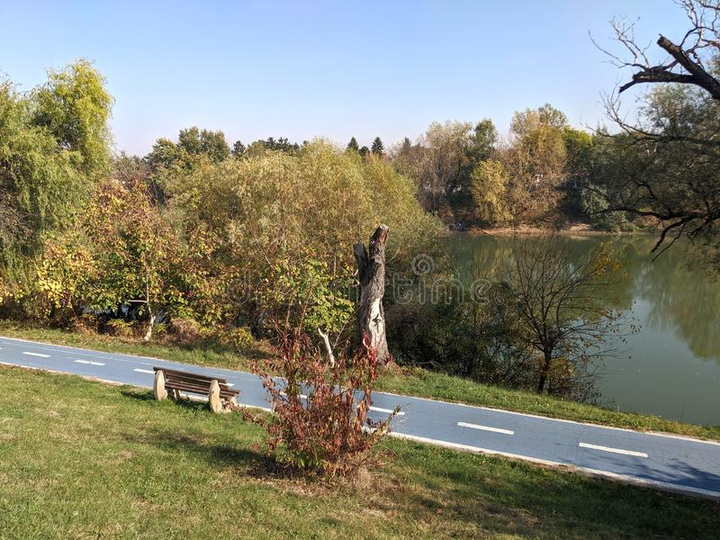 Mures river and a bicycle trail - Arad, Romania. Mures river and a bicycle trail on a sunny autumn day - Arad, Romania stock image