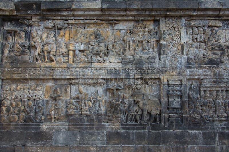 Murez les soulagements du temple antique de Borobudur près de Yogyakarta, Java, Indonésie images libres de droits