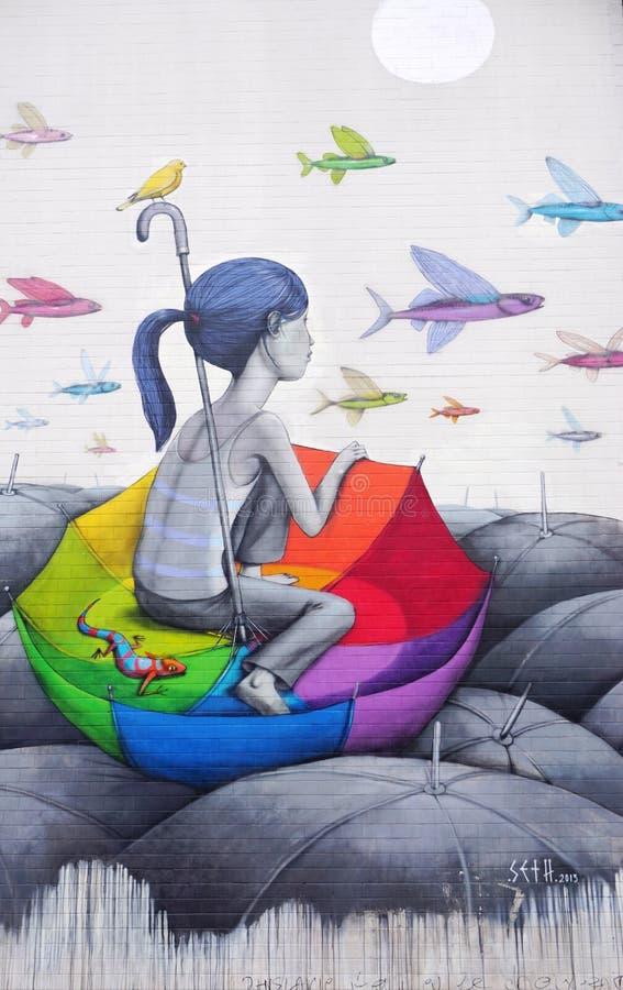 Muri la pittura murala dall'artista francese famoso Seth Globepainter della via a Parigi fotografia stock libera da diritti