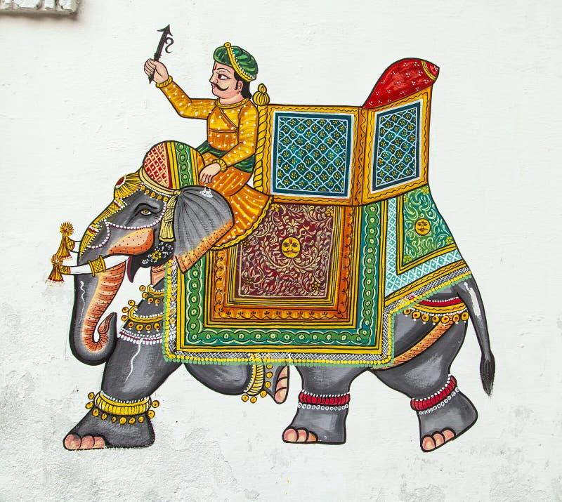 Muri la pittura in Udaipur ad una casa locale fotografie stock