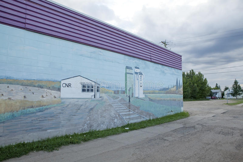 Murial pintou em uma construção, Alberta imagem de stock