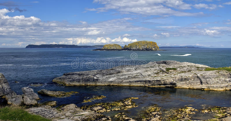 Murlough Bay and across the sea to the Mull of Kintyre Scotland, Antrim Coast royalty free stock photos