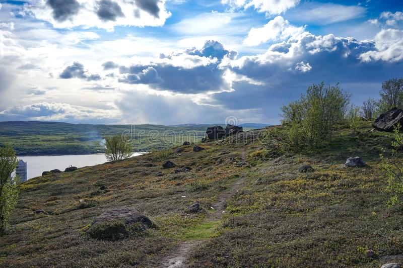 Natural landscape with tundra vegetation overlooking the Kola Bay. Murmansk, Russia-June 5, 2015: Natural landscape with tundra vegetation overlooking the Kola royalty free stock photos