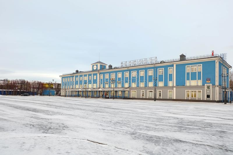 Beautiful Morskaya hotel blue building color in front of the famous the icebreaker 'Lenin'ship royalty free stock images