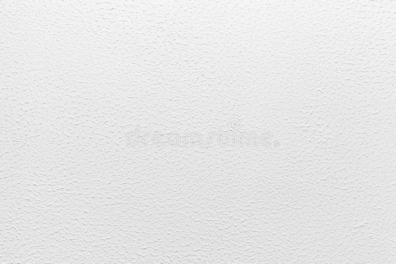 Muro de cemento blanco con el estuco decorativo foto de archivo libre de regalías