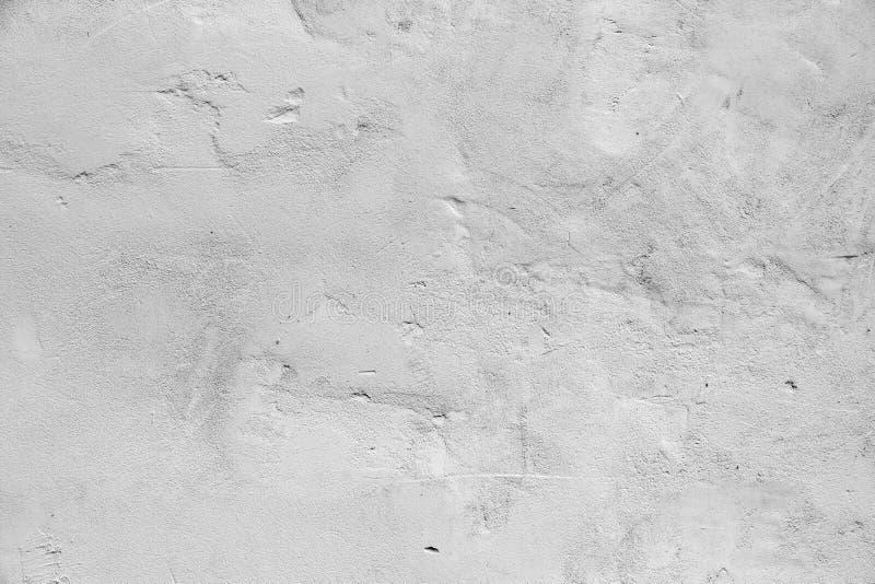 Muro de cemento gris con los detalles del alivio, fondo fotos de archivo libres de regalías